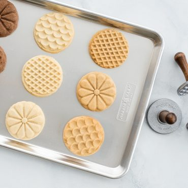 Baked stamped cookies on baking sheet