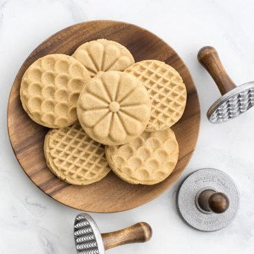 Plate of baked stamped cookies with 3 stamps