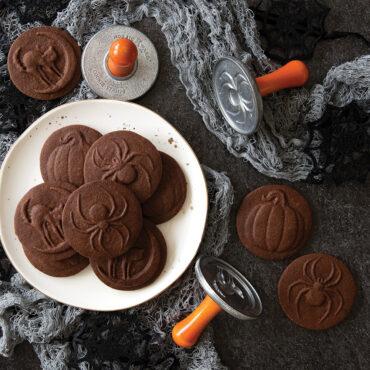 Baked Halloween stamped cookies in festive scene