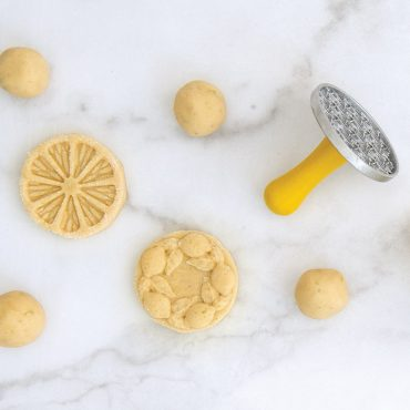 Stamped dough on marble surface with Citrus Cookie Stamps