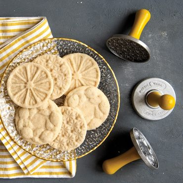 Baked citrus stamped cookies on plate