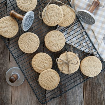 Baked stamped cookies on wire cooling rack, 3 cookie stamps