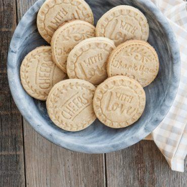 Baked stamped cookies in bowl, various designs