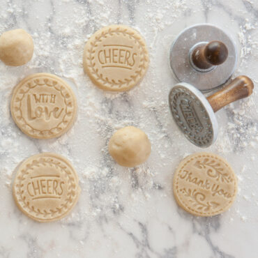 Stamped cookie dough on floured surface