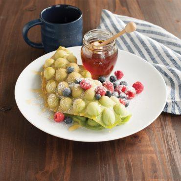 Matcha rolled bubble waffle on plate