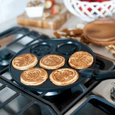 Pancake pan on stovetop with cooked Autumn pancakes