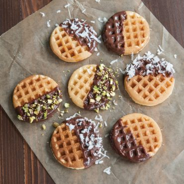 Cooked mini waffles dipped in chocolate
