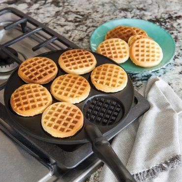 Cooked mini round waffles on pancake pan