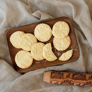 Baked embossed cookies on platter