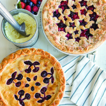 Baked pies with 2 pie top crust designs, ice cream