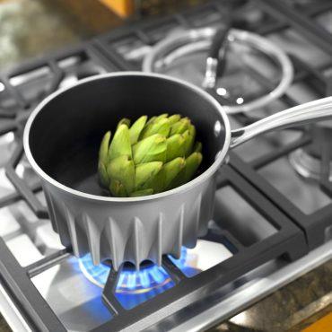 Artichoke in flare pan on stove top