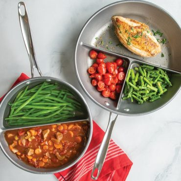 Divided pan collection- divided saucepan and skillet with cooked food in sections of pans