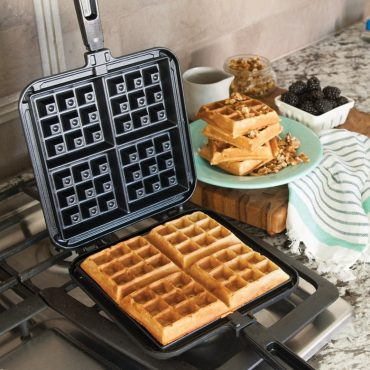Waffler on stovetop with cooked waffle