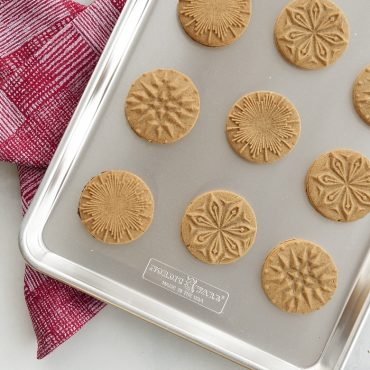 Baked stamped Starry Night cookies on half  sheet