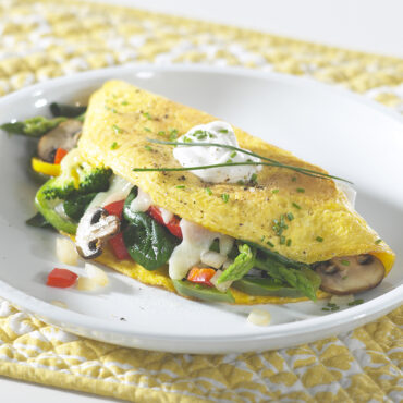 Cooked veggie omelet on plate
