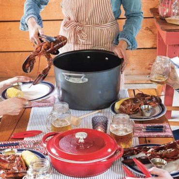 Stock pot on dinner table, braiser, plated lobster