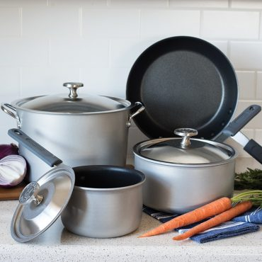 Cookware set on counter with vegetables