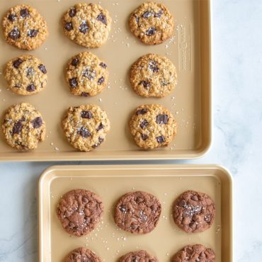 Baked cookies on two half sheet pans