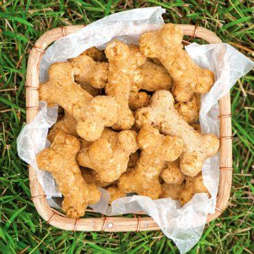 Baked bone shaped dog treats in basket