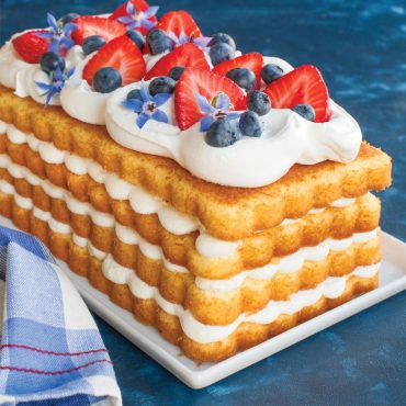 4 layer loaf cake, whipped cream filling and topping, fresh berries