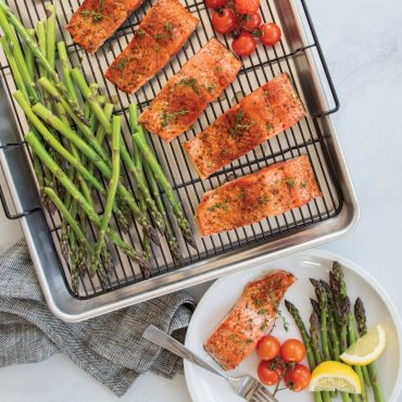 Baked salmon meal on Extra Large Oven Crisp Baking Tray, plated dinner