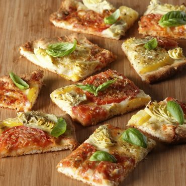 Grilled pizza cut into squares