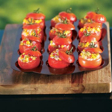 Grilled tomatoes with vegetable stuffing in pan