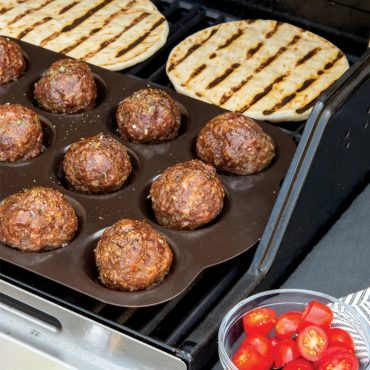 Grilled meatballs in pan, grilled pita bread, on grill