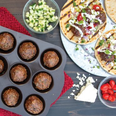 Grilled meatballs in pan; pita meatball sandwiches on plate