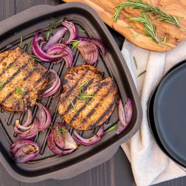 Grilled pork chops, onions, in griddle pan