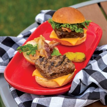 Two grilled square sliders on plate