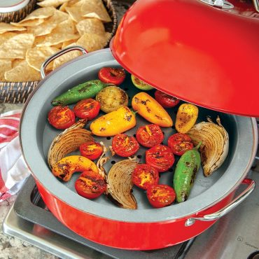 Open smoker on stovetop with vegetables