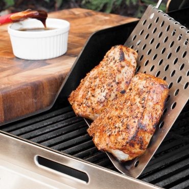 Pork chops on grill tent on grill