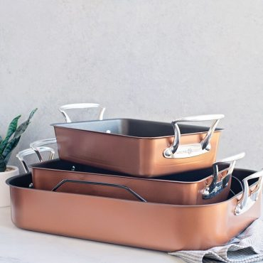 Copper Roaster Collection, 3 roaster sizes stacked with a towel