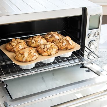 Nonstick Compact Muffin Pan in toaster oven with muffins