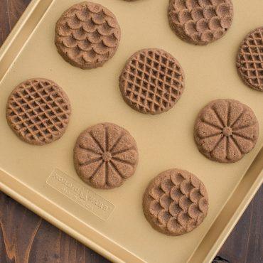 Baked stamped chocolate cookies on sheet pan