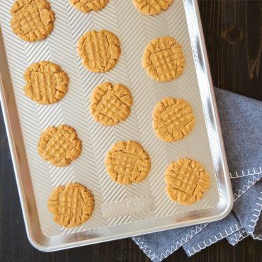 Baked peanut butter cookies on Prism sheet