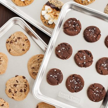 Multiple sheet pans with baked cookies