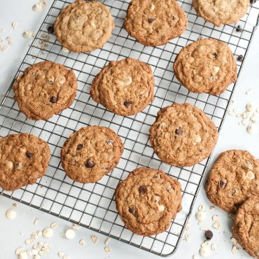 Baked chip cookies on cooling grid