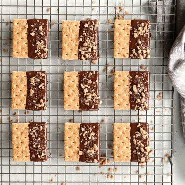 Baked chocolate dipped shortbread on grid
