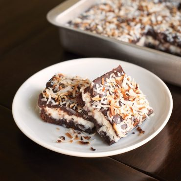 Baked chocolate bars in pan, two on plate
