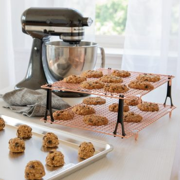 Cooling grids with baked cookies, sheet pan with unbaked cookies