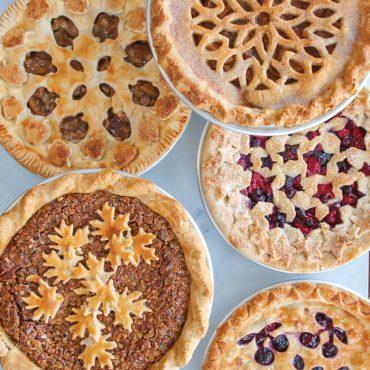Variety of baked pies in pie pan