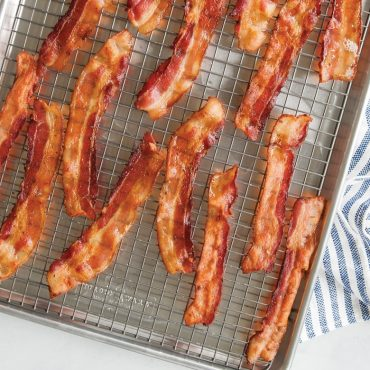 Baked bacon on grid in half sheet pan
