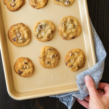 Baked chocolate chip cookies on nonstick quarter sheet pan
