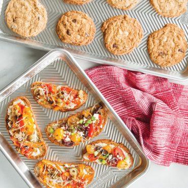 Baked vegetable bruchetta on prism quarter sheet, baked cookies on prism half sheet