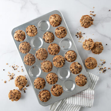 Naturals® 24 Cavity Petite Muffin Pan with baked muffins