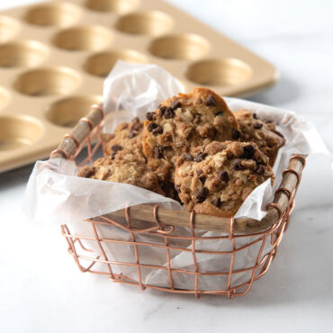 Naturals® Nonstick 24 Cavity Petite Muffin Pan with basket of granola muffins