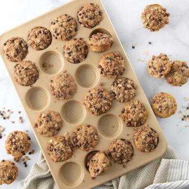 Naturals® Nonstick 24 Cavity Petite Muffin Pan with granola muffins