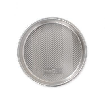 "Top view Prism 9"" Round Cake Pan, showing embossed grid design on bottom"""